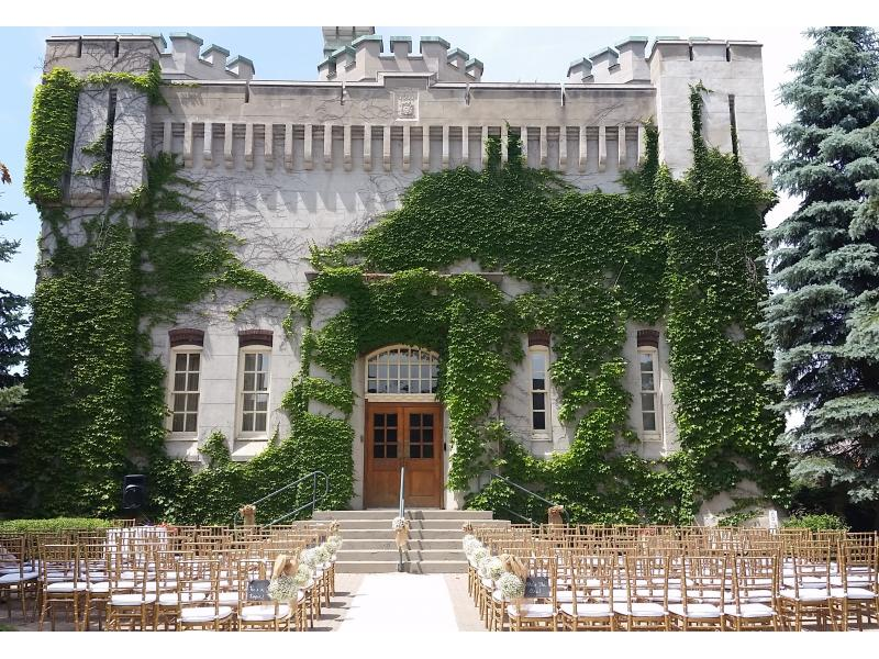 Gold Chiavari Chairs Match Perfectly To The Old Castle